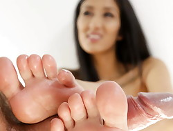 Darcia Lee does footjob on giant man meat